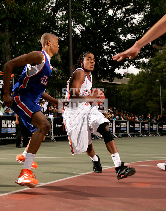 Chris Allen (20) drives to the basket with defense by Anthony Randolph (4) during the Elite 24 Hoops Classic game on September 1, 2006 held at Rucker Park in New York, New York.  The game brought together the top 24 high school basketball players in the country regardless of class or sneaker affiliation.