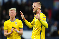 Mike van der Hoorn of Swansea City apologises to the fans at full time during the Sky Bet Championship match between West Bromwich Albion and Swansea City at The Hawthorns in Birmingham, England, UK. Sunday 08 December 2019