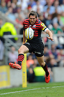 Alex Goode of Saracens chips ahead during the Aviva Premiership Final between Saracens and Northampton Saints at Twickenham Stadium on Saturday 31st May 2014 (Photo by Rob Munro)