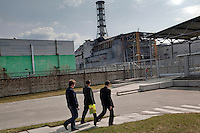UKRAINE, Chernobyl, 2010/04/7<br /> CHERNOBYL WORKERS - The workers have accustomed to silhouette of Chernobyl sarcophagus long time ago. In spite of fact that last Chernobyl reactor (Unit No. 3) has been permanently shut down in year 2000, there are still  2000 to 3000 employees working on power plant, Chernobyl, April 7, 2010. <br /> © Vaclav Vasku/EST&OST