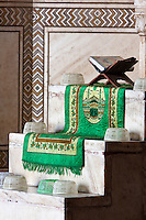 Agra, India.  Taj Mahal Mosque.  Prayer Rug Resting on Steps of the Minbar, from which the Imam Gives his Sermon.  The Quran Rests in a stand called a rehal.  Plastic hats are for worshippers who arrive without a head-cover.