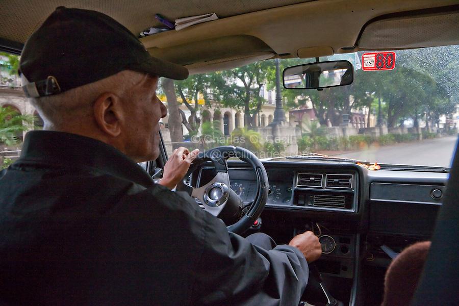Cuba, Havana.  The Prado Street Scene, Seen from inside a Taxi.