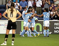 FC Gold Pride defender Brandi Chastain (6) looks on as the Red Stars celebrate Cristiane's third goal of the night.  The Chicago Red Stars defeated the FC Gold Pride 3-1 at Toyota Park in Bridgeview, IL on July 12, 2009.