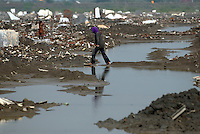 The destroyed village of Kedung Bendoh. Since May 2006, more than 10,000 people in the Porong subdistrict of Sidoarjo have been displaced by hot mud flowing from a natural gas well that was being drilled by the oil company Lapindo Brantas. The torrent of mud - up to 125,000 cubic metres per day - continued to flow three years later.