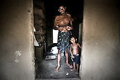 A villager is seen with his son in village Dhinkhia, in Orissa, India. The local population of small villagers along the proposed Posco site have started a campaign and do not want to give away their land for the proposed Posco factory.