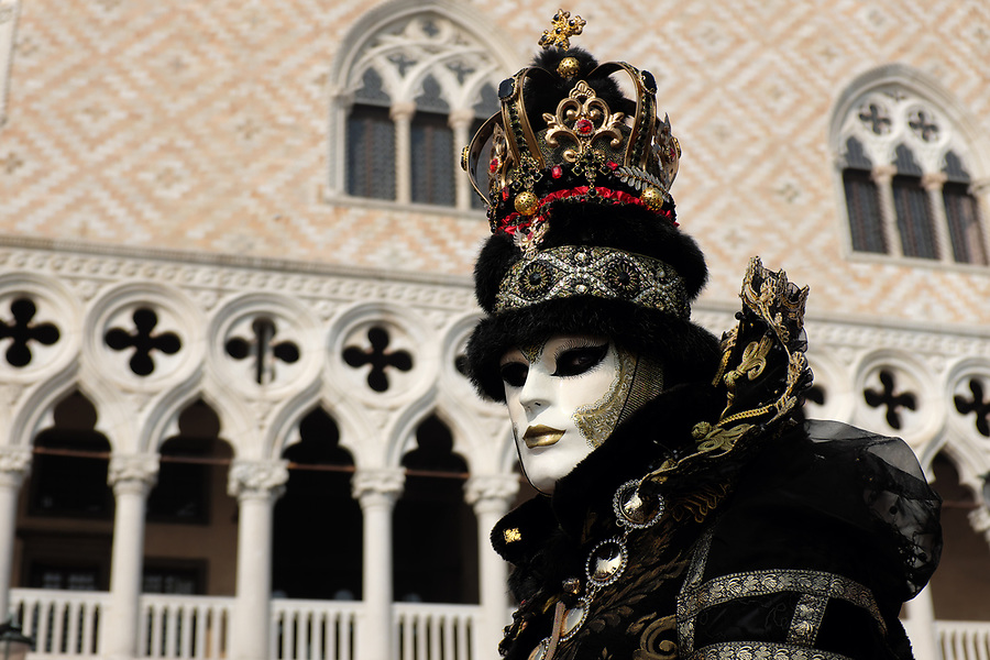 Man dressed in traditional mask and costume for Venice Carnival standing in Piazza San Marco, Venice, Veneto, Italy