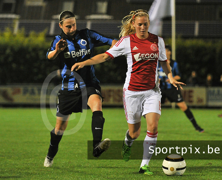 20130830 - VARSENARE , BELGIUM : Ajax' Claudia Van den Heiligenberg pictured being tackled by Brugge's Heleen Jaques (left) during the female soccer match between Club Brugge Vrouwen and Ajax Amsterdam Dames , of the first matchday in the BENELEAGUE competition. Friday 30 August 2013. PHOTO DAVID CATRY