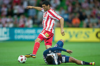 MELBOURNE, AUSTRALIA - DECEMBER 11: John Aloisi of the Heart fouls Carlos Hernandez of the Victory during the round 18 A-League match between the Melbourne Heart and Melbourne Victory at AAMI Park on December 11, 2010 in Melbourne, Australia. (Photo by Sydney Low / Asterisk Images)