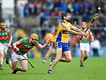 Tadgh Shanahan of Clooney-Quin in action against Cathal Malone of  Sixmilebridge during their senior county final replay at Cusack park. Photograph by John Kelly.