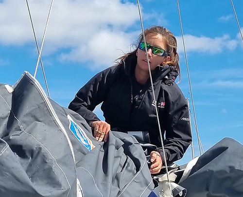 On top of the job….Pam Lee stowing the mainsail after the 24-hour session in the Bay of Biscay