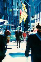 Pedestrians walking on Wall Street<br />