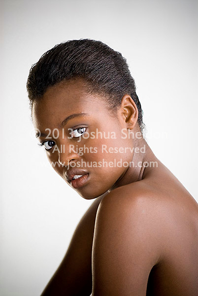 Portrait of young African American woman, side view