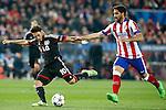 Atletico de Madrid's Raul Garcia (r) and Bayer 04 Leverkusen's Hakan Calhanoglu during Champions League 2014/2015 match.March 16,2015. (ALTERPHOTOS/Acero)