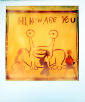 """Polaroid instant color picture of Austin's famous """"Hi How Are You"""" Mural as University of Texas students walk to class - Stock Image."""