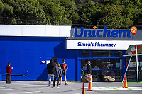 People queue at Simon's Pharmacy. Tawa town centre at midday, Wednesday, during lockdown for the COVID19 pandemic in Wellington, New Zealand on Wednesday, 15 April 2020. Photo: Dave Lintott / lintottphoto.co.nz