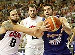 Spain's Felipe Reyes (r) and USA's Deron Williams (l) and Kevin Love during friendly match.July 24,2012. (ALTERPHOTOS/Acero)