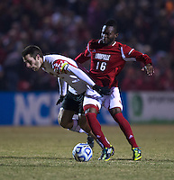 Patrick Mullins (15) of Maryland fights for the ball with Ade Akinsanya (16) of Louisville during the game at Ludwig Field in College Park, MD.  Maryland defeated Louisville, 3-1.