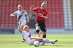 Leah Galton of Manchester United Women leaps out of danger