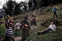Cepne family with Grandfather relaxing in Field. Historically the Yayla lifestyle has been a hardscrabble life.  This all changed with the influx of tea as a cash crop.  Now families travel to their yaylas as part-vacation and part-work because their tea crops are so lucrative.