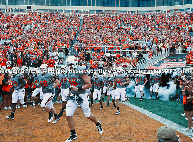 Oklahoma State Cowboys in action during the game between the Louisiana-Lafayette Ragin Cajuns and the Oklahoma State Cowboys at the Boone Pickens Stadium in Stillwater, OK. Oklahoma State defeats Louisiana-Lafayette 61 to 34.
