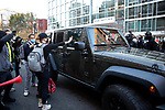 "Trump supporters in a Jeep clash with anti-Trump protesters during the ""Million MAGA March"" on November 14, 2020 in Washington, D.C.  Thousands of supporters of U.S. President Donald Trump gathered to protest the results of the 2020 presidential election won by President-Elect Joe Biden.  Photograph by Michael Nagle"