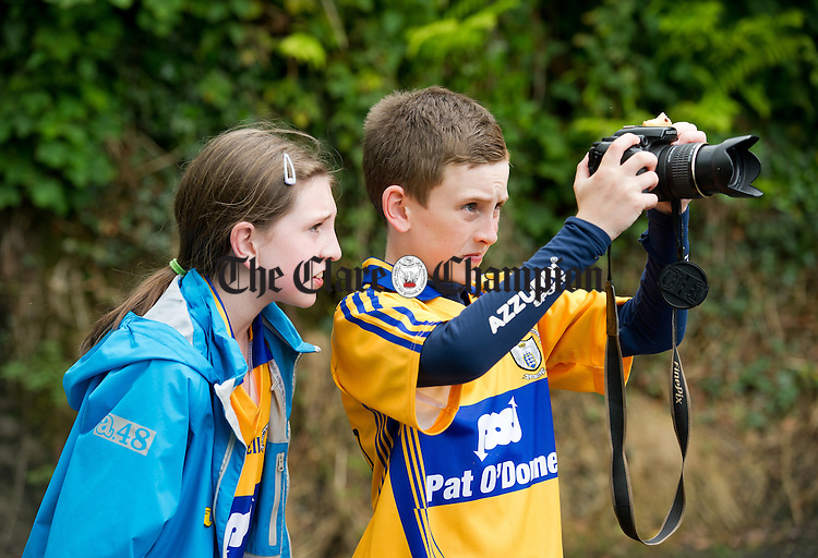 Kate and Dara Fitzgerald capturing moments on camera during the Oatfield Church re-development fund fun walk/run/cycle. Photograph by John Kelly.