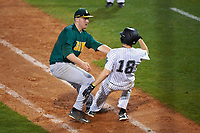 Siena Saints first baseman Joe Drpich (47) tags Austin Hale (18) during a game against the Stetson Hatters on February 23, 2016 at Melching Field at Conrad Park in DeLand, Florida.  Stetson defeated Siena 5-3.  (Mike Janes/Four Seam Images)