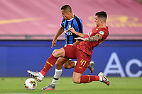 Alexis Sanchez of FC Internazionale and Roger Ibanez of AS Roma compete for the ball during the Serie A football match between AS Roma and FC Internazionale at stadio Olimpico in Roma ( Italy ), July 19th, 2020. Play resumes behind closed doors following the outbreak of the coronavirus disease. <br /> Photo Antonietta Baldassarre / Insidefoto