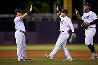 Tampa Tarpons outfielders Jasson Dominguez (20) and Juan De Leon (right) high five Jesus Bastidas (14) after a game against the Lakeland Flying Tigers on July 15, 2021 at George M. Steinbrenner Field in Tampa, Florida.  (Mike Janes/Four Seam Images)