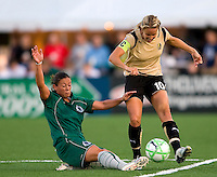 St. Louis Athletica midfielder Lisa Stoia (7) knocks the ball away fromFC Gold Pride midfielder Leslie Osborne (10) during a WPS match at Korte Stadium, in St. Louis, MO, May 9 2009. St. Louis Athletica won the match 1-0.