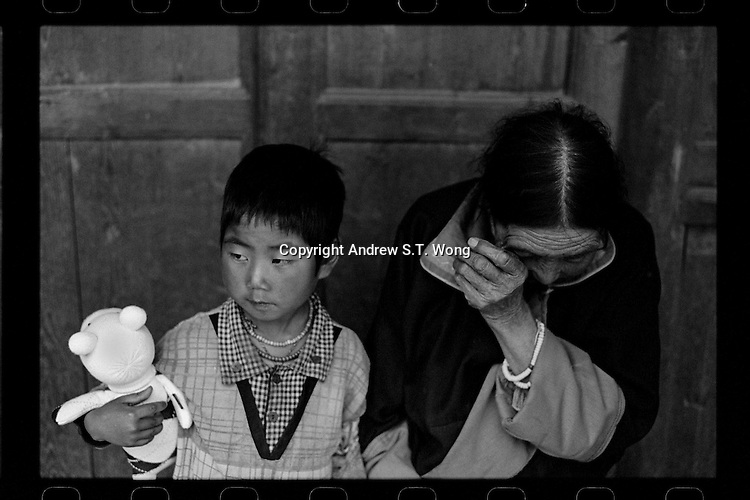 A Tibetan woman bids farewell to her granddaughter as she leaves their home in Hualong for a cleft palate operation organized by Smile Angel Foundation at hospitals in Xining, Qinghai province, China, August 2013. (Names withheld for privacy)