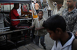Alamgir roaming around near Sealdah station the place where he lives. He is staying here for last 6 years from the time he ran away from his home due to domestic violence and poverty. As per his version his father was a drunkard and used to beat his mother for no reason. His father even could not earn enough money to buy food for their big family. Due to this traumatic situation he ran away from house at the age of seven. Ever since, the Sealdah railway station in Kolkata has been his home. As far as company is concerned, he had not much reason to miss his family. There are around 500 children, from 5 to 16 years, who live in the premises of Kolkata's second largest train terminus. Most of them addicted to Brown Sugar and sniffing industrial adhesive Dendrite. They say they don't feel hungry if they take the drugs. Their presence is conspicuous, even in a place that registers an average footfall of 1.4 million on weekdays. Their activities cover a wide range, from begging, to pulling handcarts, to petty theft, to selling odds and ends on the platform or on trains. The money, earned or ill-gotten as the case may be, is spent in procuring heroin, brown sugar, cocaine, and tubes of Dendrite. Calcutta, West Bengal, India. Arindam Mukherjee