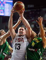 Kevin LOVE (USA) fights for the ball with Simas JASAITIS (Lithuania) and Paulius JANKUNAS (Lithuania)  during the semi-final World championship basketball match against Lithuania in Istanbul, USA-Lithuania, Turkey on Saturday, Sep. 11, 2010. (Novak Djurovic/Starsportphoto.com) .