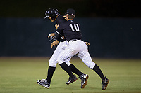 Antonio Rodriguez (left) of the Kannapolis Intimidators is tackled by teammate Mitch Roman (10) after his walk-off hit in the bottom of the 12th innings capped a comeback win over the Hickory Crawdads against the Hickory Crawdads at Kannapolis Intimidators Stadium on April 22, 2017 in Kannapolis, North Carolina.  The Intimidators defeated the Crawdads 10-9 in 12 innings.  (Brian Westerholt/Four Seam Images)