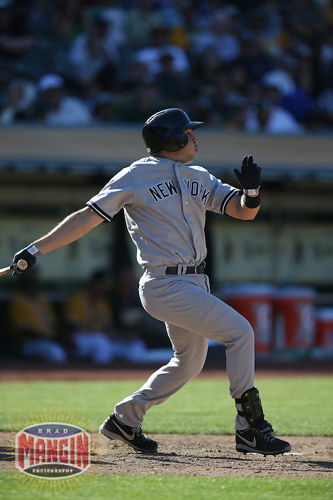 OAKLAND, CA - JUNE 13:  Mark Teixeira #25 of the New York Yankees bats against the Oakland Athletics during the game at O.co Coliseum on Thursday June 13, 2013 in Oakland, California. Photo by Brad Mangin