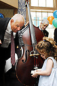 "Two-year-old Amelie Seemann (left) requests ""You Are My Sunsine"" from the Joe Simon jazz band at Commander's Palace as it reopens for brunch for the first time since Hurricane Katrina, New Orleans, Sun., Oct. 1. 2006"