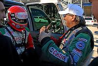 "Jan 20, 2007; Las Vegas, NV, USA; NHRA Funny Car driver Ashley Force talks with father John Force during preseason testing at ""The Strip"" at Las Vegas Motor Speedway in Las Vegas, NV. Mandatory Credit: Mark J. Rebilas"