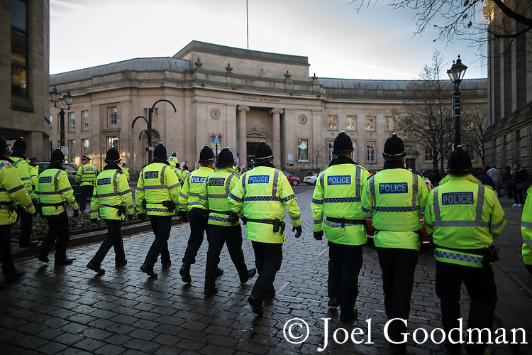"© Joel Goodman - 07973 332324 . 26/11/2016 . Bolton , UK . Police move to separate anti-fascist protesters from the anti-mosque demonstrators ,  behind Bolton Town Hall . Approximately 100 people attend a demonstration against the construction of mosques in Bolton , under the banner "" No More Mosques "" , organised by a coalition of far-right organisations and approximately 150 anti fascists opposing the demonstration , in Victoria Square in Bolton Town Centre . Photo credit : Joel Goodman"
