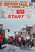 Musher Robert Bundtzen and Iditarider Ann Holt.leave the 2011 Iditarod ceremonial start line in downtown Anchorage, Alaska