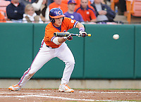 Second baseman Jay Baum (13) of the Clemson Tigers bunts in a game against the University of Alabama-Birmingham on Feb. 17, 2012, at Doug Kingsmore Stadium in Clemson, South Carolina. UAB won 2-1. (Tom Priddy/Four Seam Images)