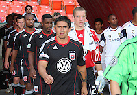 Jaime Moreno #99 of D.C. United leads the team out onto the field during an Open Cup match against Real Salt Lake at RFK Stadium, on June 2 2010 in Washington DC. DC United won 2-1.