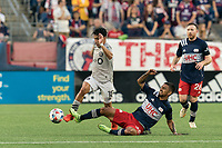 FOXBOROUGH, MA - JULY 25: A.J. DeLaGarza #28 of New England Revolution tackles Joaquin Torres #18 of CF Montreal during a game between CF Montreal and New England Revolution at Gillette Stadium on July 25, 2021 in Foxborough, Massachusetts.