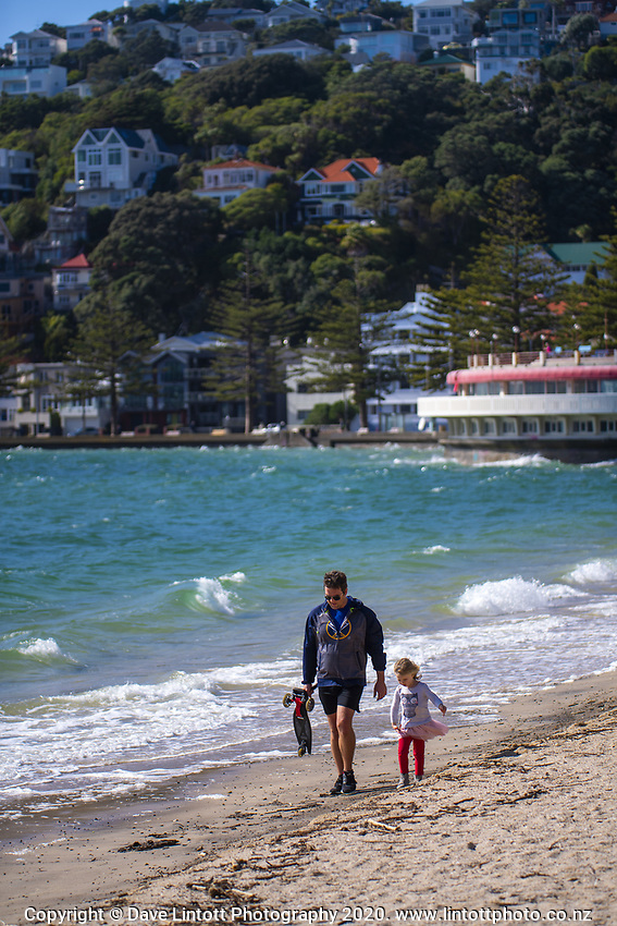 Ed Griffiths and his daughter Rose walk along Oriental Parade on Easter Monday during lockdown for the COVID19 pandemic in Wellington, New Zealand on Monday, 13 April 2020. Photo: Dave Lintott / lintottphoto.co.nz