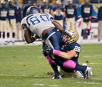 Pitt linebacker Anthony Gonzalez (28) tackles Old Dominion wide receiver Melvin Vaughn (80). The Pitt Panthers defeated the Old Dominion Monarchs 35-24 at Heinz Field, Pittsburgh, Pennsylvania on October 19, 2013.
