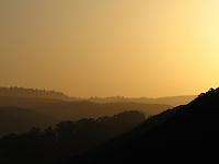Mellow sunrise light bathes the Santa Cruz Mountains east of Pescadero State Beach.