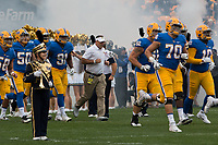 Pitt takes the field with head coach Pat Narduzzi (middle with white shirt). The Pitt Panthers defeated the Georgia Tech Yellow Jackets 37-34 at Heinz Field in Pittsburgh, Pennsylvania on October 08, 2016.
