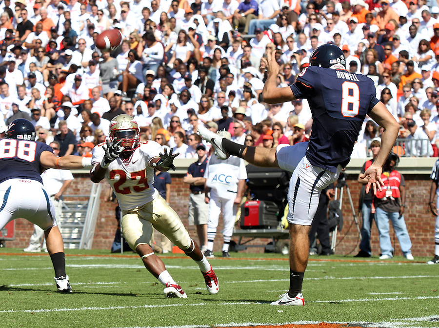 Oct 2, 2010; Charlottesville, VA, USA; Virginia Cavaliers punter Jimmy Howell (8) barely gets the punt off in front of Florida State Seminoles running back Chris Thompson (23) during the game at Scott Stadium. Florida State won 34-14.  Mandatory Credit: Andrew Shurtleff
