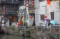 Suzhou, Jiangsu, China.  Young Couple Dressed for their Wedding Celebration, Shantang Street.