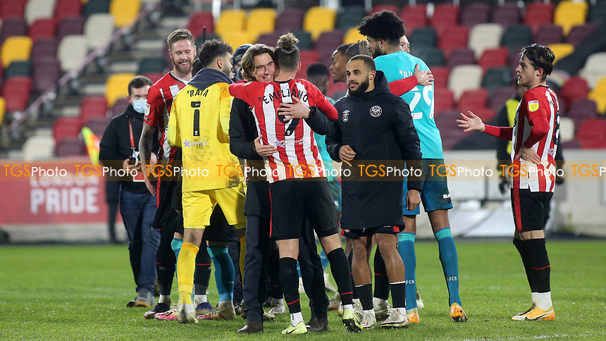 Brentford Manager, Thomas Frank, embraces Emiliano Marcondes at the final whistle to celebrate their victory during Brentford vs AFC Bournemouth, Sky Bet EFL Championship Football at the Brentford Community Stadium on 30th December 2020