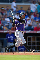 Juan Silva (1) of the Louisville Bats follows through on his swing against the Durham Bulls at Durham Bulls Athletic Park on August 9, 2015 in Durham, North Carolina.  The Bulls defeated the Bats 9-0.  (Brian Westerholt/Four Seam Images)